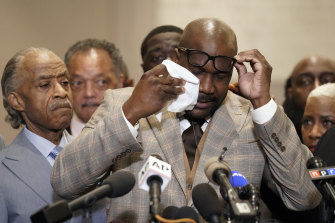 George Floyd's brother Philonise Floyd wipes his eyes during a news conference after the verdict.