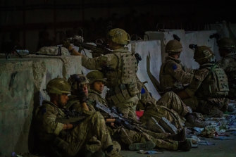 British soldiers secure the perimeter outside the Baron Hotel, near the Abbey Gate, in Kabul, Afghanistan.