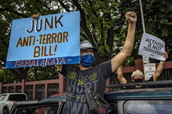 People protest against the anti-terror bill outside the Philippine Congress, despite a ban on public gatherings due to the coronavirus outbreak.
