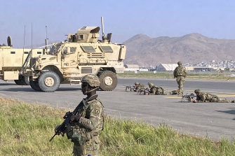 US soldiers stand guard at the international airport in Kabul last week.