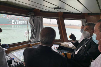 Head of the Suez Canal Authority Ossama Rabei, second right, assesses the stuck ship.
