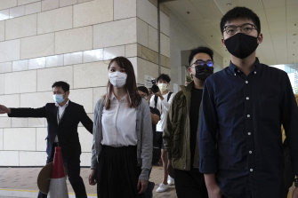 Hong Kong activist Joshua Wong arrives at a court in Hong Kong with Ivan Lam and Agnes Chow on Monday, November 22, on charges related to the besieging of a police station during anti-government protests last year.