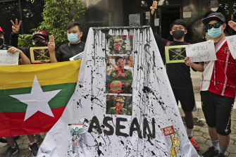 Activists display posters and defaced portraits of Myanmar's Commander-in-Chief Senior General Min Aung Hlaing in Jakarta in April.