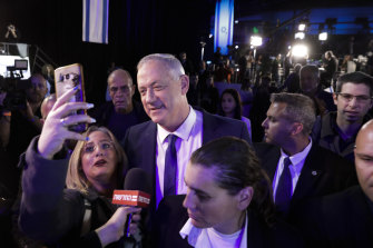 Blue and White party leader Benny Gantz arrives at party headquarters in Tel Aviv after the March 2 election.