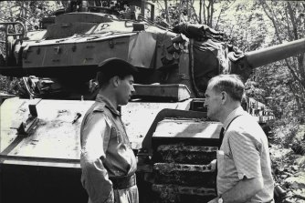 As secretary of the NSW Liberal Party, John Carrick, discusses the important role played by tanks in the 1st Australian Task Force area, South Vietnam, with Captain Bernard Sullivan in 1968.