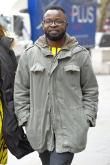 Felix Ngole arrives at court in London, where he challenged a ruling that he was lawfully removed from a Sheffield University course after being accused of posting comments about homosexuals and bisexuals on a Facebook page.