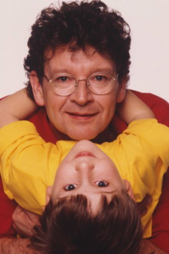 """With Samuel at a Father's Day shoot in 1995: """"All credit goes to Samuel for staging the scenario. He had an adorable smartness about him,"""" says Symons."""