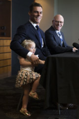 Family club: Halle  Morris crashes dad John's press conference while Sharks CEO Barry Russell looks on.