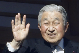 Akihito waves to well-wishers in Tokyo in January.