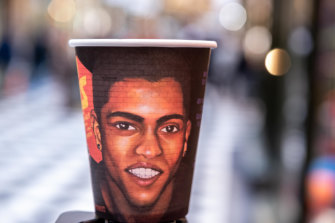 The coffee cup with the image of Tej Chitnis.