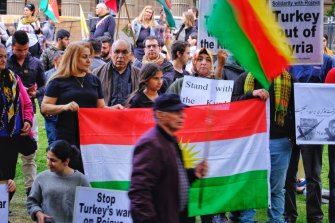 Protesters taking part in a Kurdish rally in front of the State Library in Melbourne on Saturday.