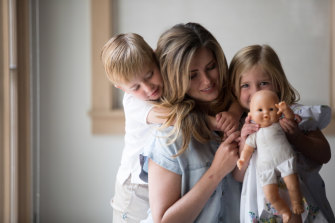 Eve Wiley, who learned through DNA testing that her biological father was her mother's fertility doctor, with her children Hutton and Scarlett at her home in Dallas.