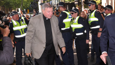 Cardinal George Pell arrives at Melbourne Magistrates Court on Monday morning.