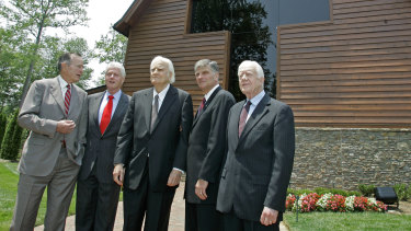 Former presidents George H.W. Bush, Bill Clinton and Jimmy Carter (right) join Franklin Graham (second right) and his father Billy Graham in front of the Billy Graham Library in 2007.