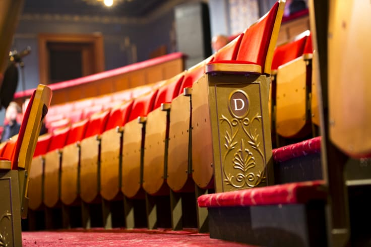 Custom-designed seats replace the theatre's notoriously-uncomfortable folding chairs.