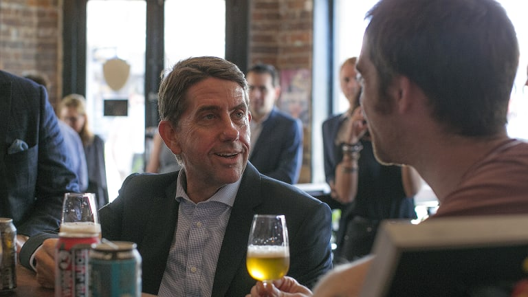 State Development Minister Cameron Dick tastes a beer with BrewDog co-founder Martin Dickie.