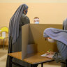 Divisions run deep as Poland holds delayed presidential election
