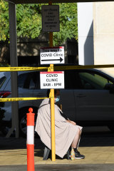 A man sits outside the Sir Charles Gairdner Hospital COVID Clinic.