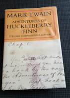 "Mark Twain's ""Adventures of Huckleberry Finn"", which is based on the author's original handwritten manuscript."