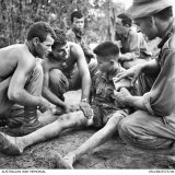 Three soldiers from the 3rd Battalion, The Royal Australian Regiment (3RAR), treat a captured North Vietnamese soldier.