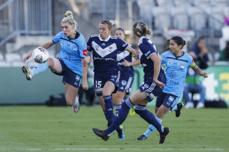 Sydney FC's Remy Siemsen and Victory's Amy Jackson battle for possession.