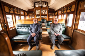 Same train of thought: Volunteers Tom Clark (left) and twin brother Kevin inside the vintage Red Rattler train.