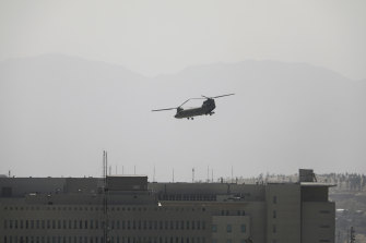 A US Chinook helicopter flies over the US Embassy in Kabulon Sunday as the evacuation mission begins.