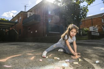 Michelle Allebi let her daughter Jessica play with chalk in the front driveway, which upset a neighbour.