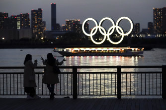 Illuminated Olympic rings float in the waters off Odaiba island in Tokyo.