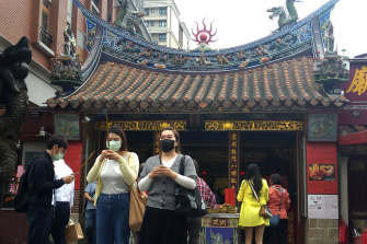 People visit a temple in Taipei, Taiwan, on Monday. The island managed the pandemic without lockdowns.