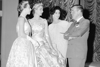 Norman Hartnell visiting David Jones in 1958 with models Maureen Duval (centre), Maggi Eckardt (right) and Diane Masters (left) on 20 October 1958.