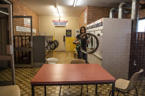 Katrina White cleans her empty Laundromat in Narooma.