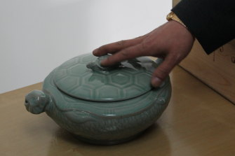 A pot used to transport the turtles to restaurants in China.