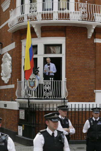 Assange makes a statement from the Ecuador embassy in 2012.
