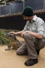 Reptile Keeper Stuart Kozlowski with Naga the Komodo dragon.