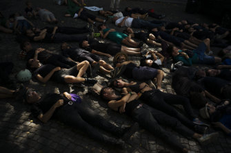 "An Extinction Rebellion ""die-in"" in Paris called on Brazil's President Jair Bolsonaro to act to protect the Amazon rainforest."