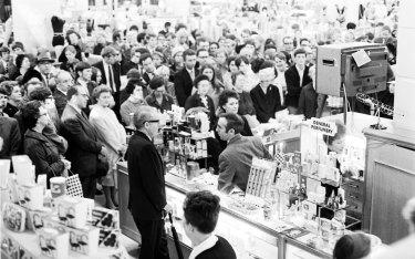 Crowds gather around a television in David Jones department store in Sydney to watch a live telecast of the Apollo ll moon landing, July 21, 1969.
