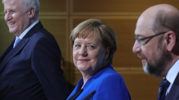 Merkel reveals the wurst-fuelled coalition deal that may save her job
