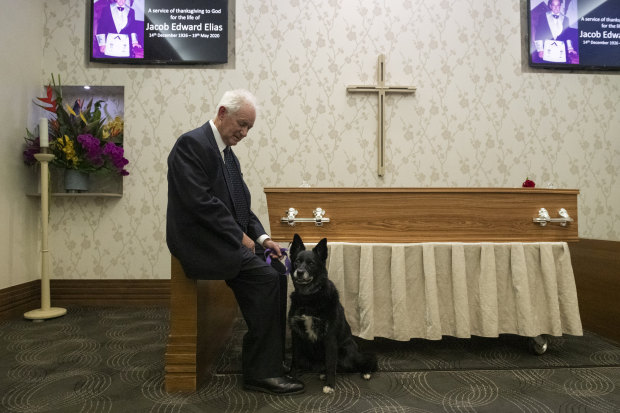 """Son-in-law Bob Mitchell and Cindy the dog at Jacob Elias' funeral. """"She was there for (Jacob) living alone, she was there for him on the last day and there for him when we celebrated his life."""" Mr Mitchell said."""