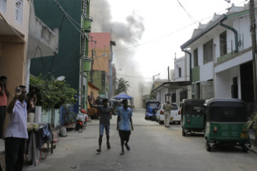 Smoke rises after a vehicle parked near St Anthony's shrine exploded in Colombo on Monday.