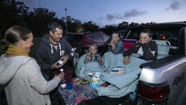 Lisa and Michael Montesin from Killarney Heights with their children (from left) Noah, Zoe and Bailey at Ku-ring-gai Drive In Cinema.