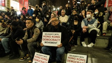 "Protesters hold pro-Hong Kong signs at the ""Stand With Hong Kong"" rally at Martin Place on Friday night."