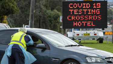 A drive through coronavirus testing clinic at the Crossroads Hotel in Casula on Wednesday.