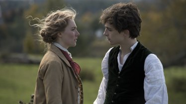 Saoirse Ronan as Jo and Timothee Chalamet as Laurie in Little Women.