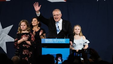 A victorious Scott Morrison  takes to the stage on election night.