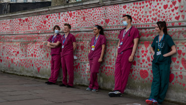 NHS workers at the National COVID-19 Memorial opposite Parliament.