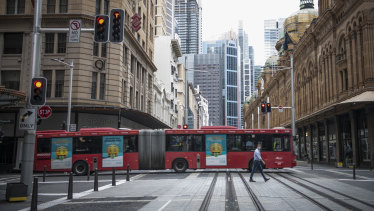 Normally busy streets are quiet in Sydney and Melbourne as commuters work from home and visitors stay in.