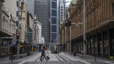 The virus has left city streets, like George Street in Sydney, empty.