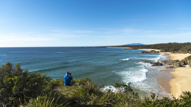 Andrew Nye looks for fish at Mullimburra Point on the NSW South Coast.