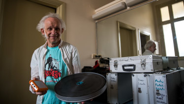 Celluloid versus digital: projectionist Alan Butterfield with a multi-movie hard-drive and a 20-minute film reel.